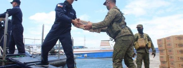 Military assists in unloading food packs